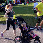 Kindra  and her Baby Trend Expedition at a race