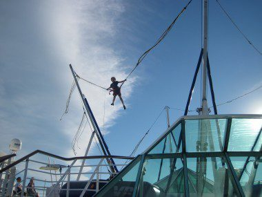A view of the sea from a bungee trampoline atop a behemoth cruise ship is incredible