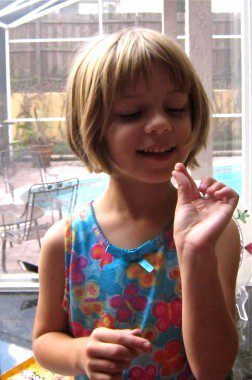 G Admires Her First Lost Tooth