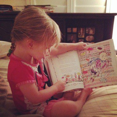 My daughter showing us how to read.