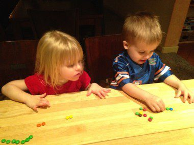 The kids sorting and counting M&Ms.