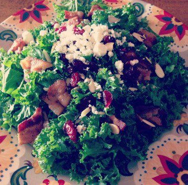 Massaged kale salad with bacon, feta, almonds and dried cranberries