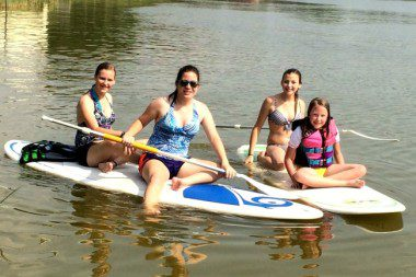 four girls paddle boarding