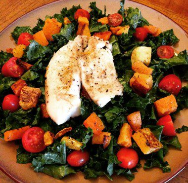 Massaged kale salad with roasted butternut squash, tomatoes and tilapia