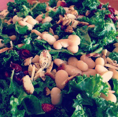 Massaged Kale with dried cherries, warm white beans and sliced almonds
