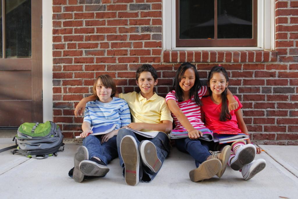 Kids-Sitting-Sidewalk