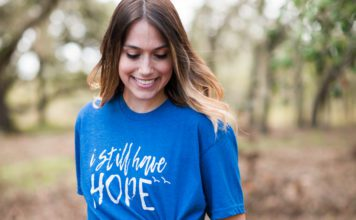 woman wearing infant loss tshirt that says I still have hope