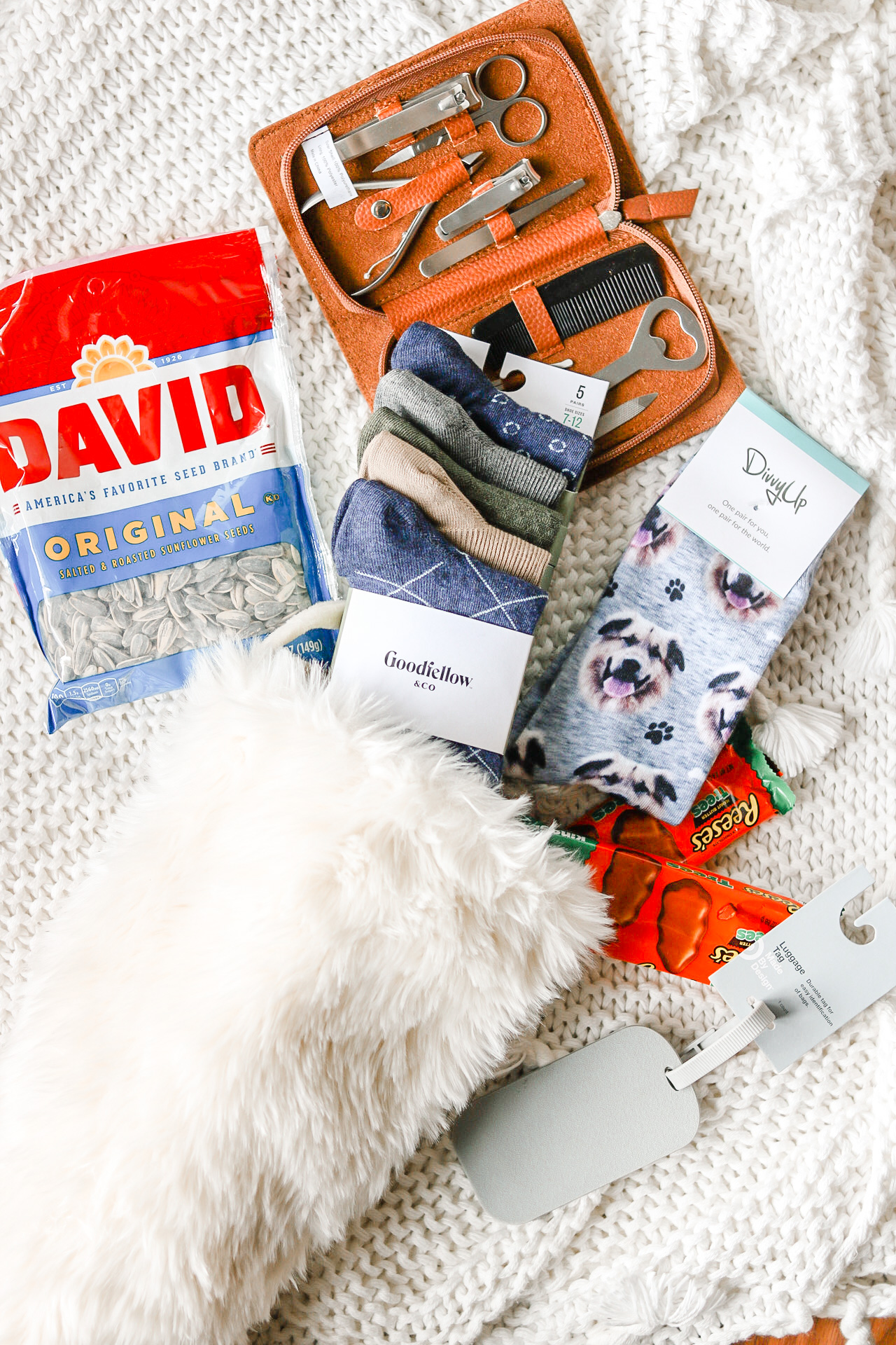 close up of stocking stuffer ideas for men in white fur christmas stocking