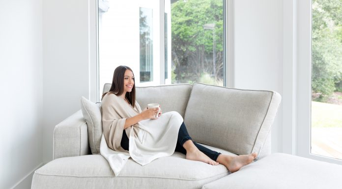 why you should wake up before your kids, woman sitting on couch with coffee wearing zestt organics