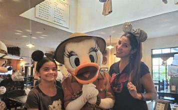 Mom and daughter with Daisy Duck at Disney's Animal Kingdom restaurant Tusker House