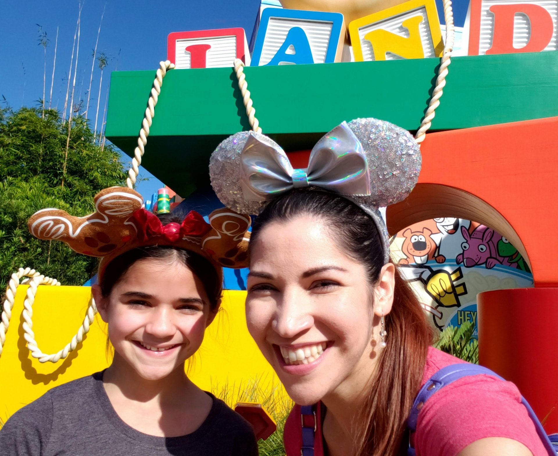 Mom and daughter smiling at Toy Story Land inside DIsney's Hollywood Studios