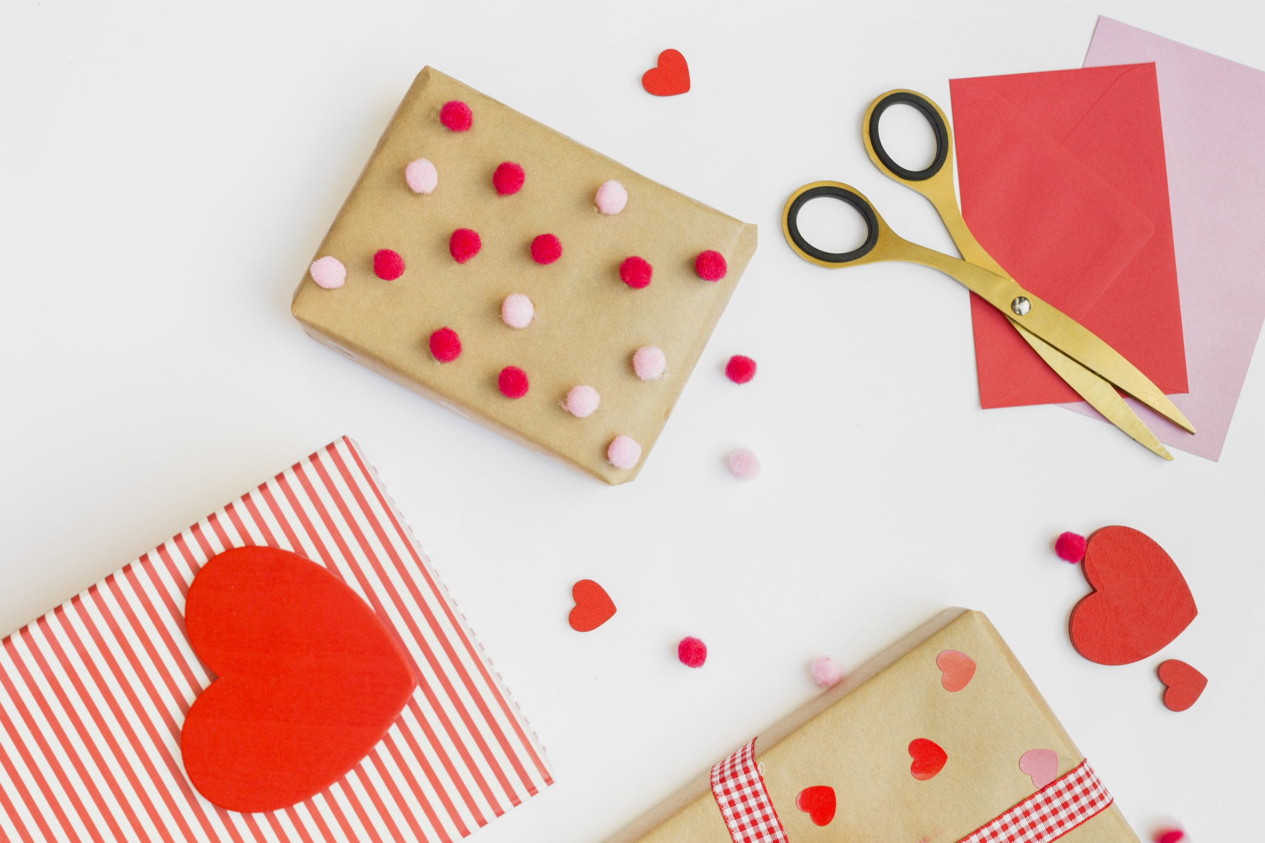 gift-boxes-with-small-red-hearts-white-table-scaled.jpg