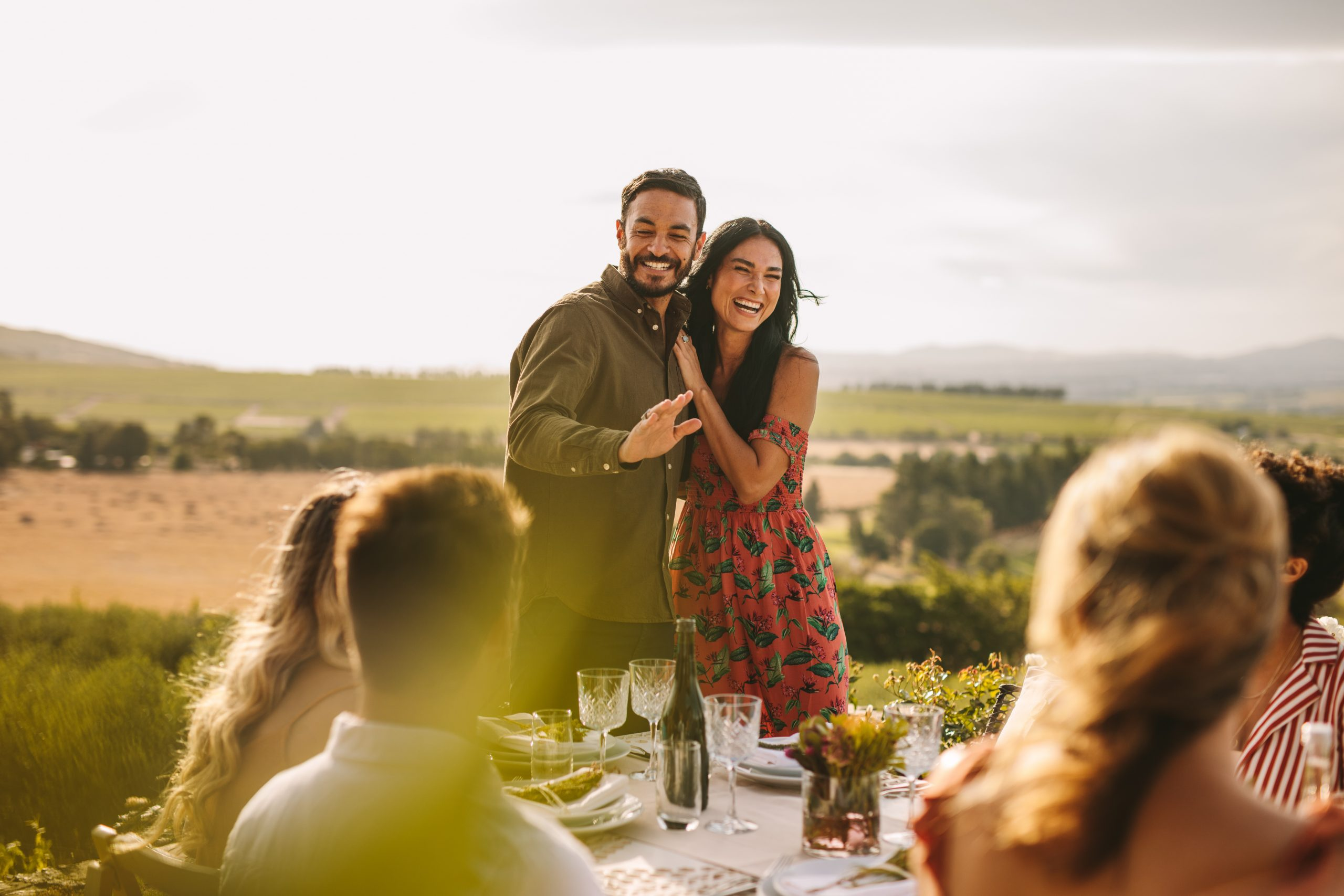 Couple at a party announcing their marriage to their friends