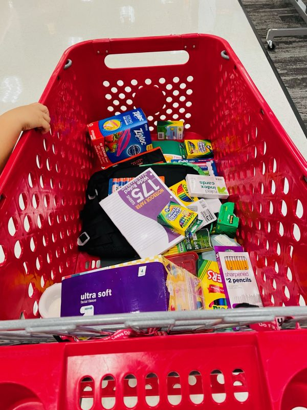Target shopping cart filled with school supplies