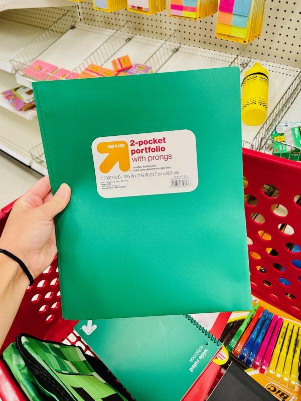 green plastic school folder with prongs