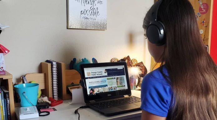 Tween girl doing virtual school on her laptop