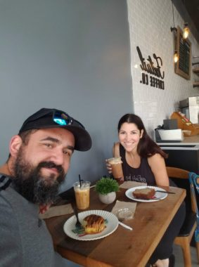 Smiling couple coffee date at Foxtail Coffee in Windermere, Florida